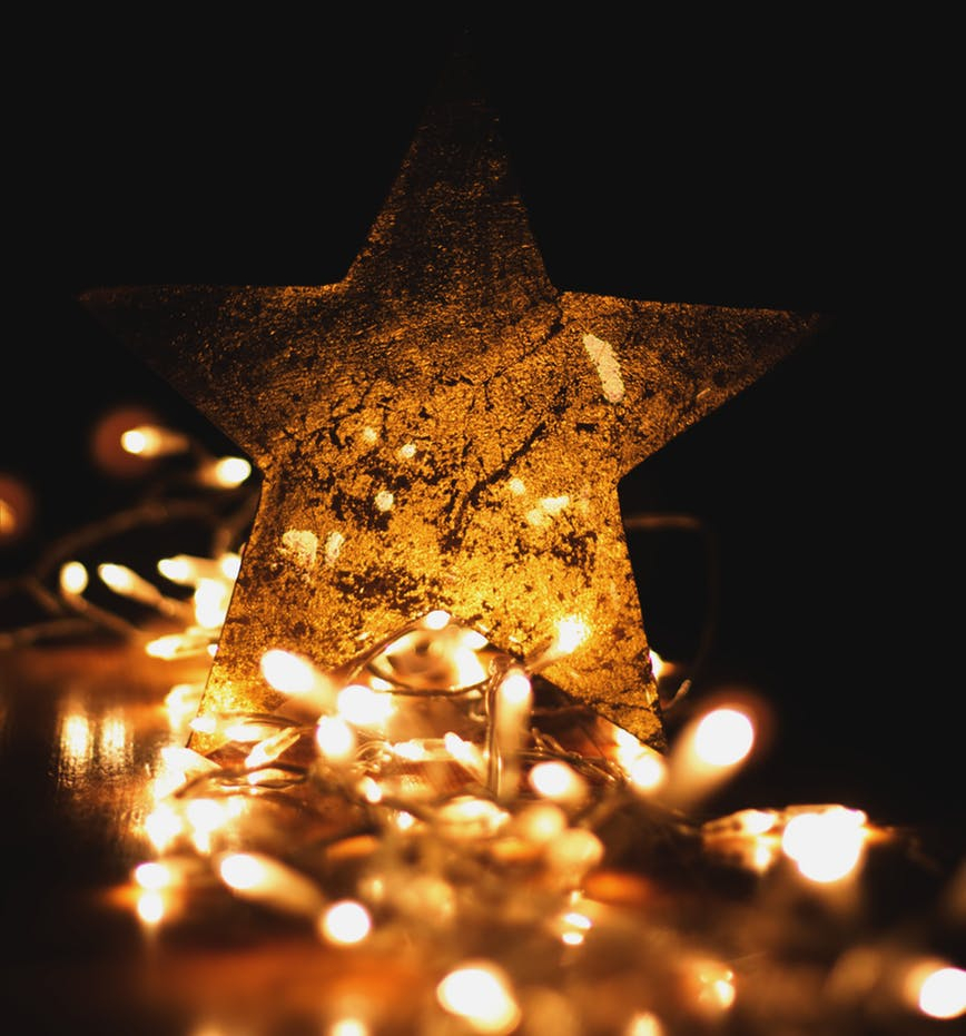 Small lights illuminate a star.